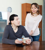 Woman asking for money from husband — Stock Photo