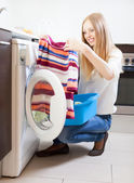 Long-haired woman with clothes  — Foto Stock