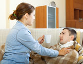 Woman caring for sick husband — Stock Photo