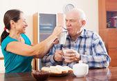 Loving mature couple having tea — Stock Photo