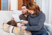 Couple giving tablets to son — Stock Photo