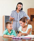Family doing homework  — Stockfoto