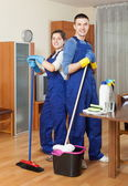 Smiling cleaners team working — Foto de Stock
