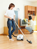 Amicable couple doing housework   — Stock Photo