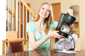 Woman with new electric coffee maker — 图库照片