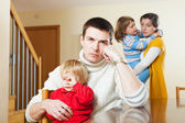 Family of four after quarrel in home — Stock Photo
