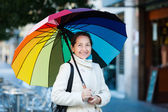 Mature woman with umbrella — Stock Photo