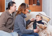 Parents caring for sick boy — Stock Photo