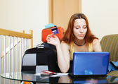 Woman buying tickets or reserving resort online — Stock Photo