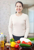 Mature woman in kitchen — Foto Stock