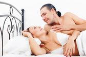 Loving middle-aged couple awaking together  — Zdjęcie stockowe