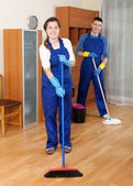 Cleaners cleaning in room — Stock Photo