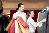 Joyful couple at boutique — Stock Photo