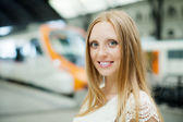 Girl waiting train   — Stock Photo