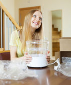 Happy girl with new electric steamer   — Stock Photo