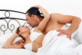 Adult couple having sex on bed   — Stock Photo