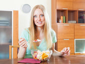 Positive  blonde woman eating  fruit salad  — Stock Photo