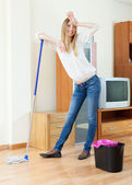 Woman washing floor with mop — Stock Photo