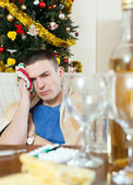 Man having hangover during  holidays at home — Stock Photo