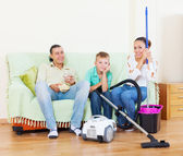 Ordinary family of three finished housework — Stock Photo