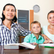 Parents and son doing homework — Stock Photo