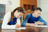 Workers filling in questionnaire — Stock Photo