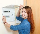 Smiling woman near power control panel — Stock Photo