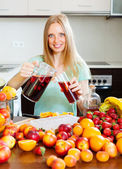 Cheerful woman pouring beverages   to glass — Stock Photo