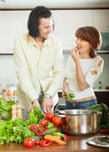 Flirting couple  with vegetables in  kitchen  — Stock Photo