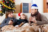 Happy family on sofa at home — Stock Photo