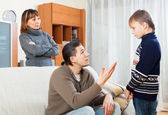 Serious parents berating their son — Stock Photo