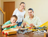 Family modeling something with instruments — Stockfoto