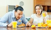 Happy couple having breakfast with croissants — Foto de Stock