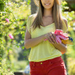Young woman in yard gardening — Stock Photo #48986471