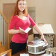 Young red haired housewife with multicooker — Стоковое фото