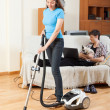 Girl cleaning while man resting — Stock Photo #48987331