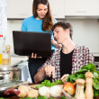 Girl shows new recipe on laptop — Stock Photo #48987609