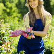 Smiling  gardener in blue uniform — Stock Photo #48987711
