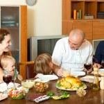 Happy family eating chicken — Stock Photo #48987823