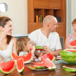 Happy family eating watermelon — Stock Photo #48987921
