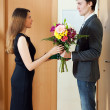 Wife takes flowers from husband — Stock Photo #48988359