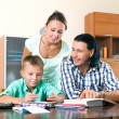 Family doing homework together — Stock Photo #48988477