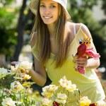 Female florist working in garden — Stock Photo #48989149
