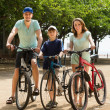 Family cycling through street — Stock Photo