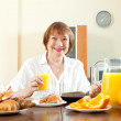 Mature  woman having breakfast — Stock Photo #48989561