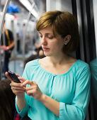 Female passanger calling by mobile   — ストック写真