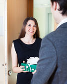Pretty woman giving gift to man — Stock Photo