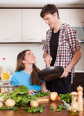 Guy and pretty girl cooking — Stock Photo