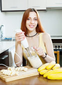 Cheerful woman  making milk shake — Stockfoto