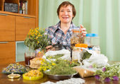 Elderly woman with medicinal herbs — Stock Photo